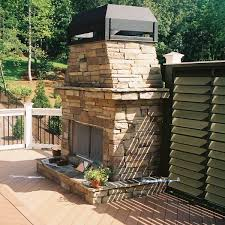 stone outdoor fireplace on low