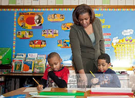 Mediabakery - Photo by Age Fotostock - Detroit, Michigan - First grade  teacher Ivy Bailey helps two students at MacDowell Elementary School