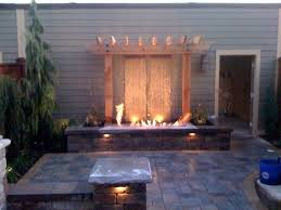 water feature with fire pits backyard