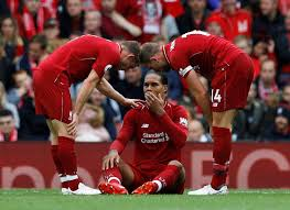 Virgil Van Dijk injury scare as ...