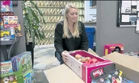 PressReader - Sentinel & Enterprise: 2019-12-15 - Bemis Assoc. again  collects piles of gifts for children