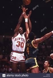 Bernard King of the New York Knicks shooting over Adrian Dantley on Stock  Photo - Alamy