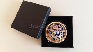 decorative golden mirror in a box