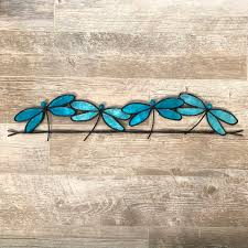 design dragonflies on a wire wall