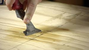 how to remove a l and stick tile