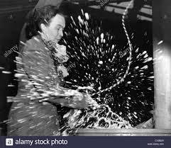 Reporter Adela Rogers St.Johns christening the combat cargo ship Stock  Photo - Alamy