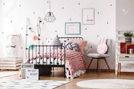 Colorful Pillows On Knit Pink Blanket On Bed In Cute Kids Bedroom Stock Photo Picture And Royalty Free Image Image 85015667