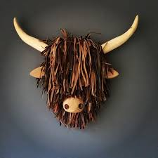 animal heads on wall highland cow
