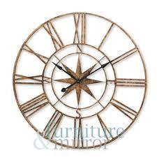 gold nautical compass skelton clock