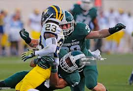 Montae Nicholson and Byron Bullough of the Michigan State Spartans... News  Photo - Getty Images