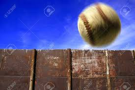Baseball Flying Through The Air With Clouds Sky And Fence In Stock Photo Picture And Royalty Free Image Image 1312229