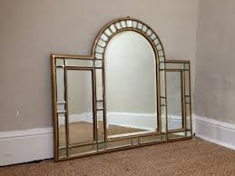 an art deco arched overmantle mirror c