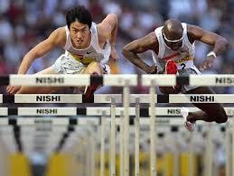 Liu Xiang defeats Allen Johnson in Japan