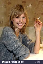 dpa) - French actress Clemence Poesy smokes during a break of the Stock  Photo - Alamy