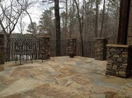 stone patio with wrought iron railing