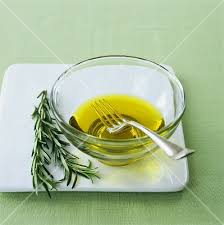 olive oil in small glass bowl with fork