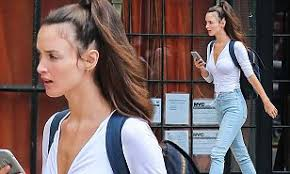 Charlotte Le Bon looks effortlessly chic in a white top and skinny ...