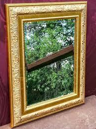 ornate gold mirror beveled