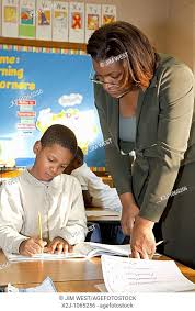 Detroit, Michigan - First grade teacher Ivy Bailey helps a student at  MacDowell Elementary School, Stock Photo, Picture And Rights Managed Image.  Pic. X2J-1065256 | agefotostock
