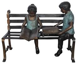 reading books on bench bronze statue