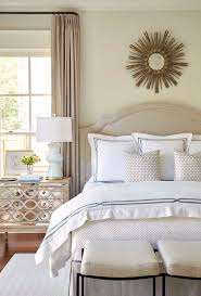 gray bedroom with mirrored nightstand