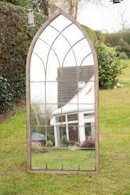 metal arched rustic outdoor mirror