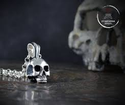solid silver skull pendant without jaw