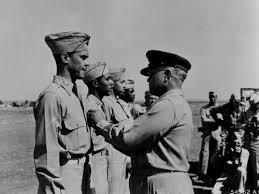 Gen. Benjamin O. Davis pins the Distinguished Flying Cross on his ...
