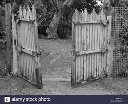 Black And White Monochrome Photo Of An Open Wooden Gate Stock Photo Alamy