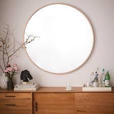 metal framed oversized round mirror