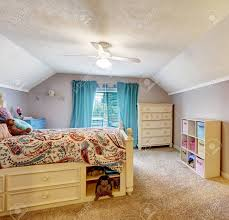 Kids Room Interior With Vaulted Ceiling Wooden Bed With Drawers Stock Photo Picture And Royalty Free Image Image 31999561