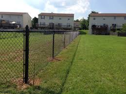 Chain Link Fence Is Still A Popular And Economical Solution To Fence In Your Yard Vinyl Coated Chain Link Fence Chain Link Fence Installation Backyard Fences