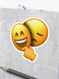 emoji sad face under happy mask