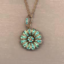 turquoise pendant with a tiny diamond