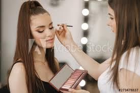 makeup artist work in her beauty studio