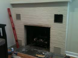 wood over painted brick fireplace