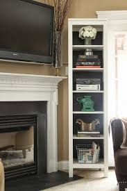 cable box and xbox within bookshelf