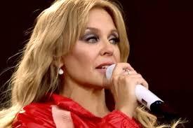 Kylie Minogue breaks down in tears at ...