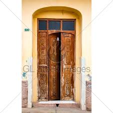 tattered brown door with glass above on