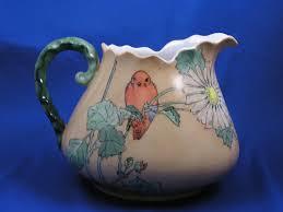 "Porcelain Blank Arts & Crafts Bird with Flowers Design Pitcher (Signed ""Goldie  Smith Kinder""/c.1910-1940) | Arts and crafts, Porcelain art, Flower designs"