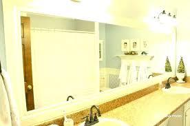 white frame framing diy wood mirrors