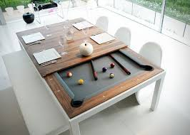 dining table hides a pool table