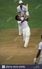 Indian cricket player Kapil Dev batting ...