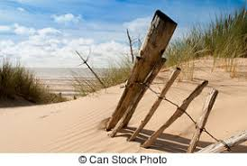 Remnants Of Old Fence On A Beach Central Seascape View Of A Broken Old Fence Remnants On A Sand Dune With Sea In The
