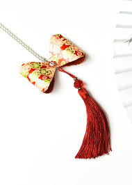 red bow tie pendant with tassels