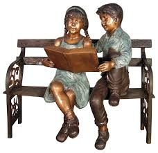 girl reading on a bench sculpture