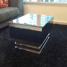 black mirrored coffee table with