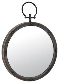 round mirror with ring and rivet trim