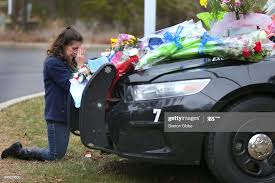 Jeanette Smith from Harwich kneels and prays in front of the cruiser...  News Photo - Getty Images