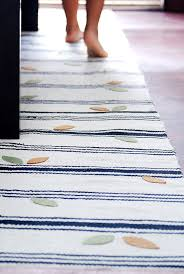 make some ikea rugs into a runner